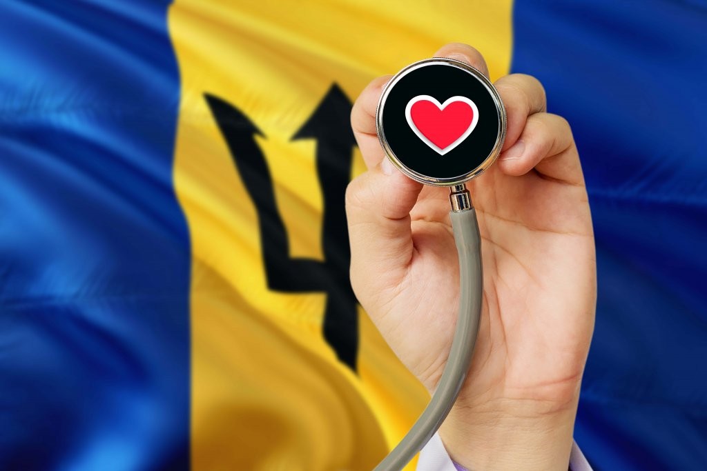 Doctor holding stethoscope with red love heart with National Barbados flag background - MBBS in Barbados